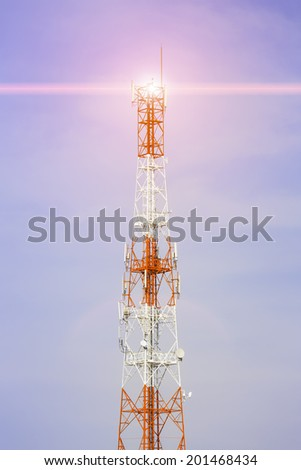 Telecommunication antenna with blue sky background. - stock photo