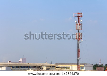Telecommunication Cell tower and radio antenna on Building. - stock photo
