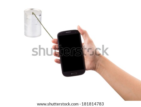Telecommunication concept image of female hand holding a smart phone connecting to a tin can phone.