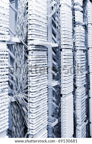 Telecommunication equipment of network cables in a datacenter. - stock photo