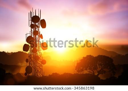 Telecommunication mast television antennas on sunset - stock photo