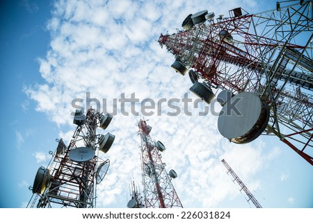 Telecommunication mast TV antennas wireless system technology with blue sky in the morning - stock photo