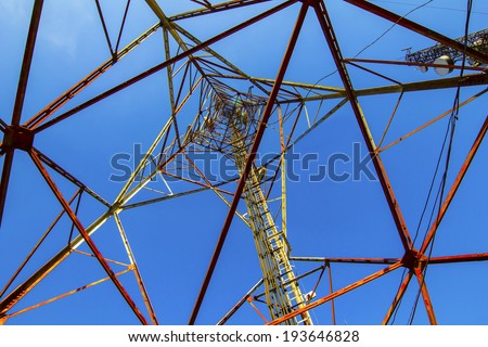 Telecommunication mast with microwave link antennas over a blue sky - stock photo