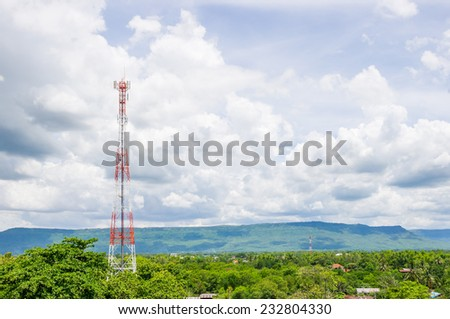 Telecommunication Radio Antenna Tower with blue sky with cloud. - stock photo