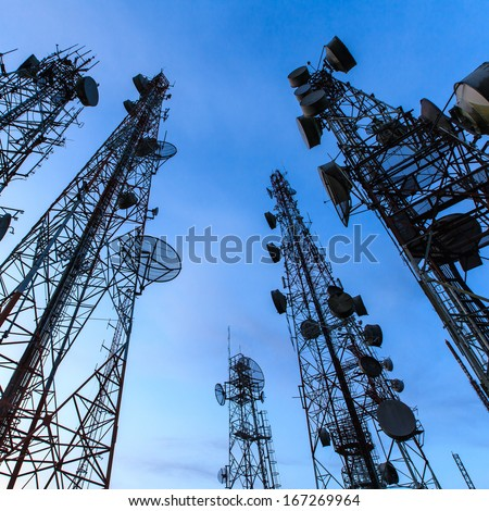 Telecommunication tower against the blue sky - stock photo