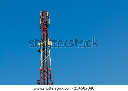 Telecommunication tower for cellular signaling and communication with blue sky. - stock photo