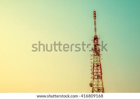 Telecommunication tower mast TV antennas wireless technology with sunset vintage tone - stock photo