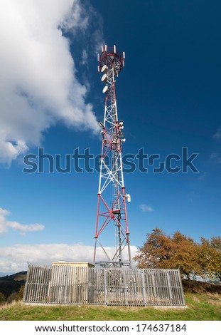 Telecommunication tower on the hill. - stock photo