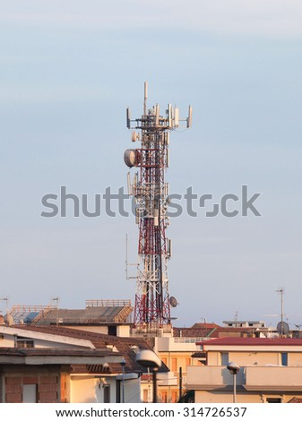 Telecommunication tower with antennas at sunset