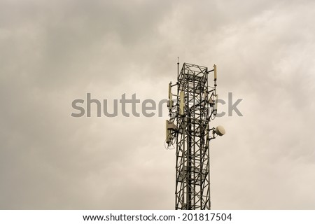 Telecommunication tower with antennas in the mist - stock photo