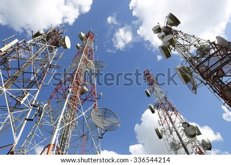 Telecommunication tower with blue sky and cloud - stock photo
