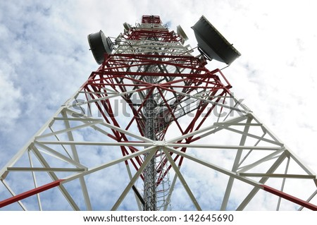 Telecommunication tower with cell phone antenna system   - stock photo