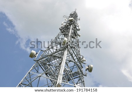 Telecommunication tower with cell phone antennas - stock photo