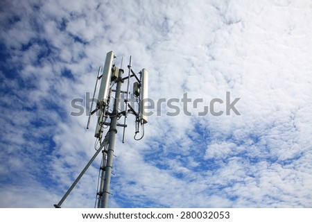 Telecommunication Tower with clouds and blue sky
