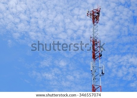 Telecommunication tower with the blue cloud sky background - stock photo