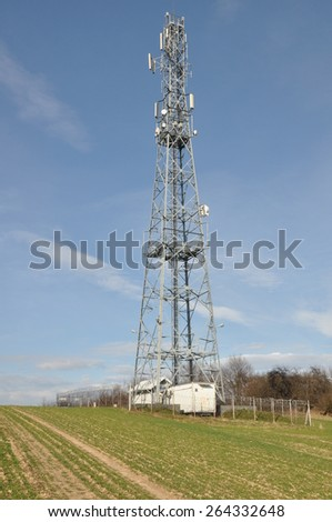 Telecommunication towers on an agricultural field - stock photo
