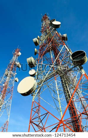 telecommunication towers with blue sky - stock photo