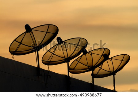 Telecommunications dish in silhouette light