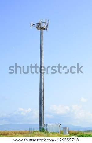 Telecommunications tower. Mobile phone base station in a blue sky background. - stock photo