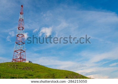 Telecommunications tower over blue sky background. - stock photo