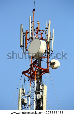 Telecommunications tower, painted white and red in a day of clear blue sky - stock photo