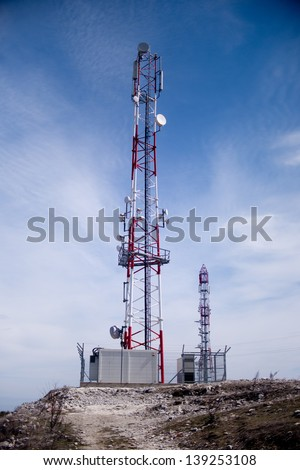 Telecommunications tower seated on top of a hill