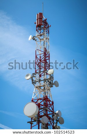Telecommunications tower with blue sky day background