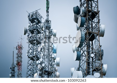 telecommunications towers against a unreal sky