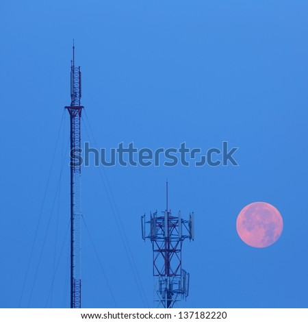 Telecommunications towers near the secret sky after the moon - stock photo