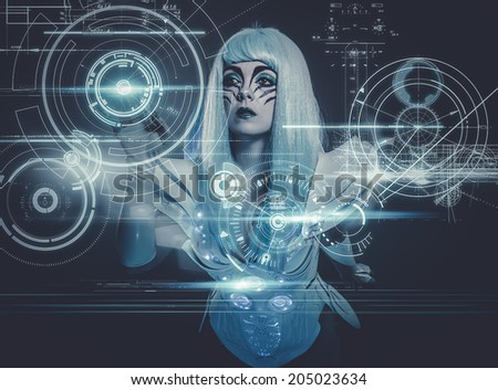 telecommunications woman controlling a future panel of lights and futuristic instruments - stock photo