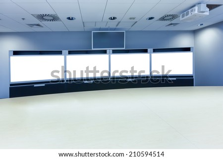 teleconference, video conference and telepresence screen display business meeting room - stock photo