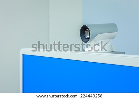 teleconference, video conference or telepresence camera with blue screen display - stock photo