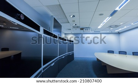 teleconferencing, video conference and telepresence business meeting room - stock photo