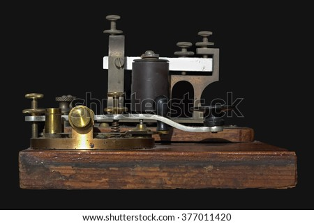 Telegraph key on black background. Telegraph key is a switching device used primarily to send Morse code.  - stock photo