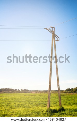 Telegraph pole on meadow