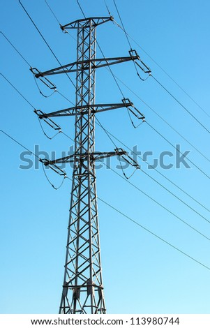 Telegraph pole with wires in blue sky