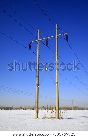 Telegraph poles in the snow, closeup of photo