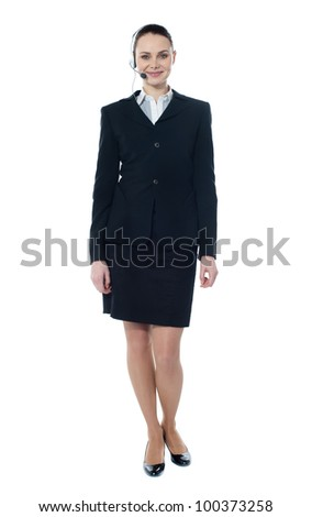 Telemarketing girl posing in headsets against white background, smiling - stock photo