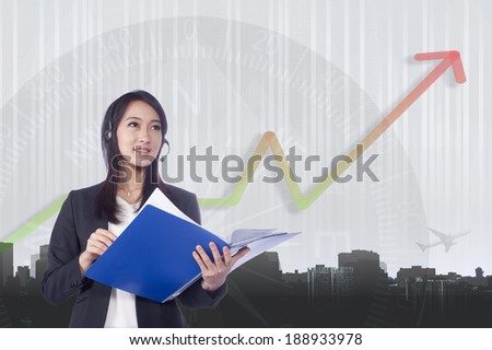 Telemarketing headset woman from call center smiling happy talking in hands free headset device. Multicultural mixed race Chinese Asian / business woman in suit isolated on white background.