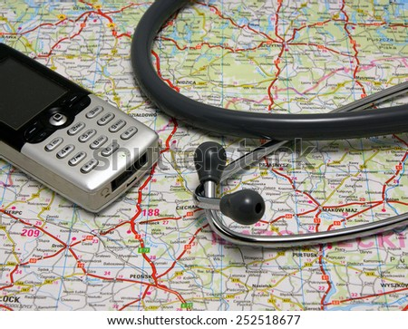 Telemedicine, telehealth set: Stethoscope and mobile phone on the road map
