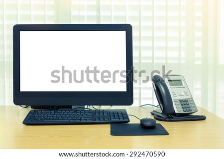 telephone and computer on table work of room service office - stock photo