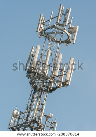 telephone and intenet communications tower against blue sky