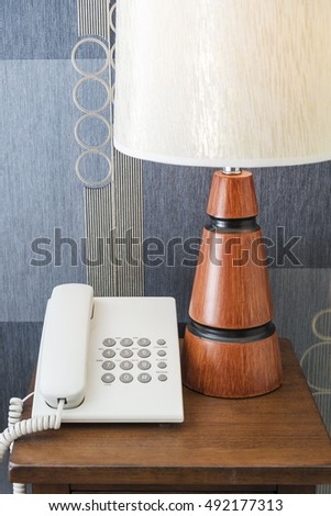 Telephone and lamp on the desk
