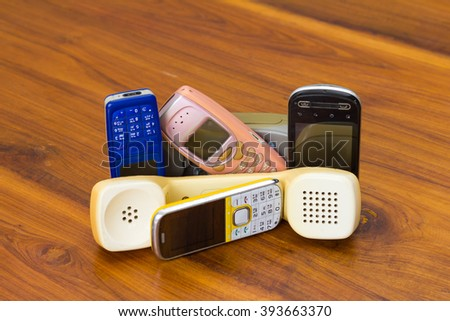 Telephone and mobile versions of old traditional and placed the overlap onto a wooden ancient pattern. - stock photo