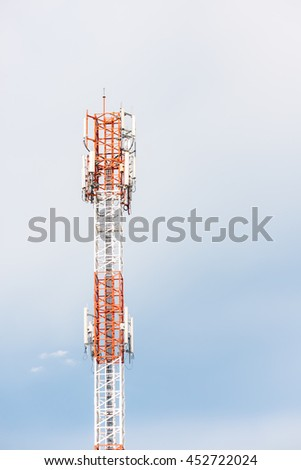 Telephone antennas for broadband communication on a tower with a blue sky background