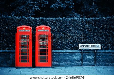 Telephone box in London street. - stock photo