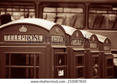Telephone box in street with historical architecture in London in black and white. - stock photo