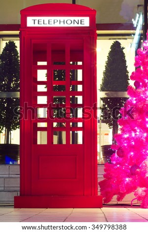 Telephone box with christmas decorate the night - stock photo