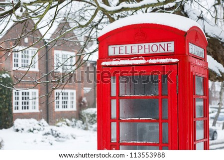 Telephone box with snow - stock photo
