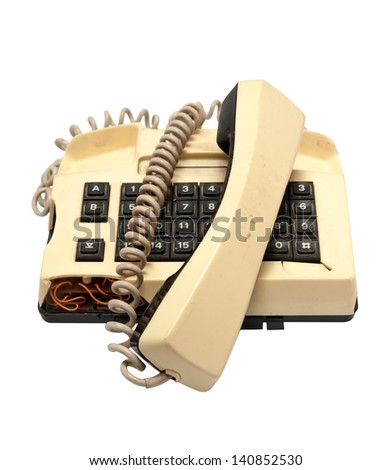 Telephone collection - Broken classical model of phone isolated on white background - stock photo